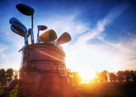 golf clubs at sunset